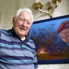 Jim with a painting presented to him by the Ilford branch of the Parachute Regimental Association.
