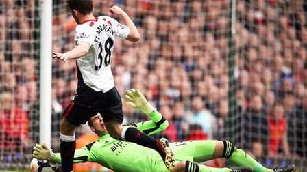 Adrian brushes the ball away from Liverpool's Jon Flanagan but the visitors were still awarded a penalty