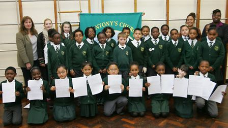 Pupils from St. Anthony's school with the letters they sent on to Nando's