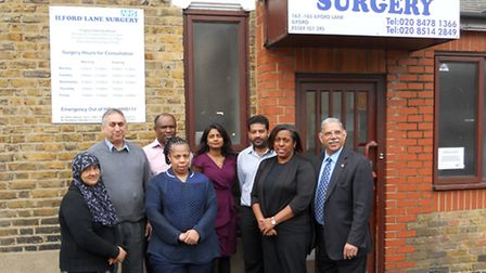 Dr Chidi Okorie and Dr Sambhavi Sheedy with patients, a nurse, reception staff and Patient Participation Group chairman...