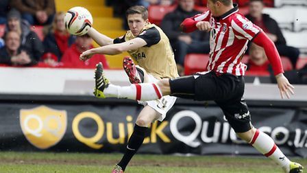 John Lundstram swings in a cross during Orient's draw at Sheffield United. Pic by Simon O'Connor