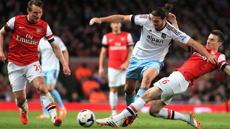 Barclays Premiere League: Arsenal v West Ham United. Andy Carrol makes his way through Arsenal's Kallstrom, left, and...