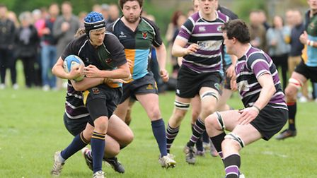 Hackney captain Alex O'Hara in action against Belsize Park in Saturday's top-of-the-table clash. Pic: Paolo Minoli