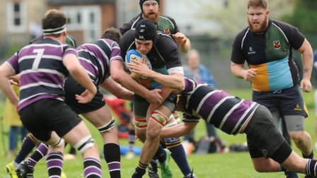 Ben Chamberlain attempts to force his way through the Belsize Park defence. Pic: Paolo Minoli