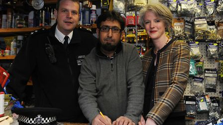 Left to right: Inspector Simon Crick, shop manager Waseem Butt and Councillor Sophie Linden