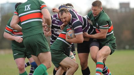 Fred House (centre) was on the scoresheet against Old Actonians. Pic: Paolo Minoli