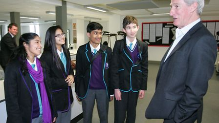 Jeremy Paxman with students from school 21