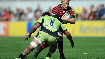 Saracens' Jackson Wray is tackled by Northampton Saints' Samu Manoa at Allianz Park