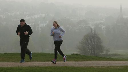 Joggers on Hampstead Heath last Friday, as London Ambulance Service has seen a rise in the number of people calling 999...