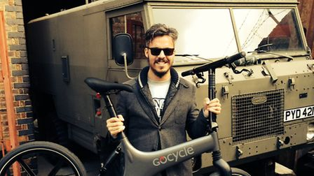 Ben Jaconelli of fullycharged.com who was reunited with his £2,500 bike, next to the army truck he pursued the thief in