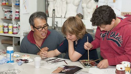 Portrait artist, Tai Schierenberg, helping young artists at University College School in Hampstead. Picture: Nigel Sutton