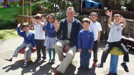 Monty Python's Michael Palin with children at Carlton Primary School, where he will hold a talk to raise funds for a...