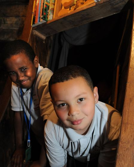 Abas, 10, and Cameran, 10, in the secret passage way at Hackney Pirates