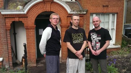 Aurimas (24), Martin Kozubski (31), and Ecko (28) are now living in the former Hampstead Police Station. Picture: Tom...