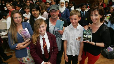 Childrens authors Sharon Gosling, Kevin Brooks and Ali Sparkes with school pupils