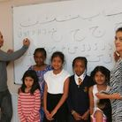 Lovepreet Singh and Julliette Chowdhury with children who will learn Urdu and Panjabi at the community centre in Ilford
