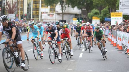 Cyclists in the Tour de France going through Stratford High Street