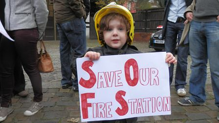 A young campaigner outside Belsize fire station earlier this year
