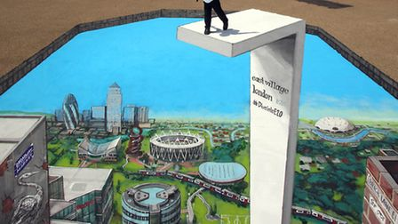 """Alieu Gardo, 4, looks nervoulsly over the """"edge"""" of a paiting by 3D Joe & Max in the Olympic Park. Picture: Geoff..."""
