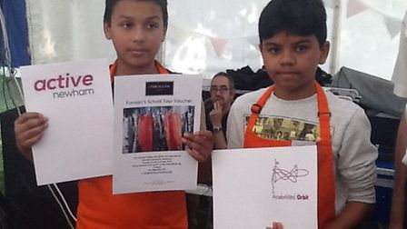Eman and Diego with their certificates