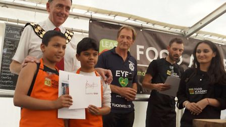 Eman and Diego receiving their prizes off the Mayor