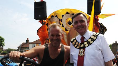 Sir Robin Wales, Mayor of Newham with a float driver on the Mayor's Newham Show parade