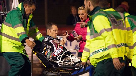 After prolonged trackside treatment, Lakeside Hammers captain Davey Watt is taken off in an ambulance (pic: Ray...