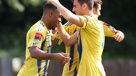 Ryan Imbert (left) and his Romford team-mates celebrate scoring the second goal in their 4-0 win over Burnham Ramblers on...