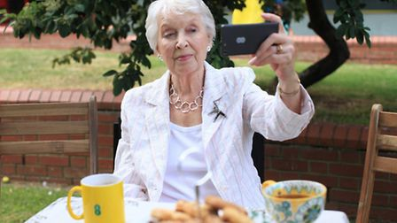 Eastender actress June Whitfield makes a selfie as part of a national campaign, sponsored by EE, to raise awareness of...