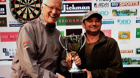 Barry Hearn presents Darren Webster with his prize last year