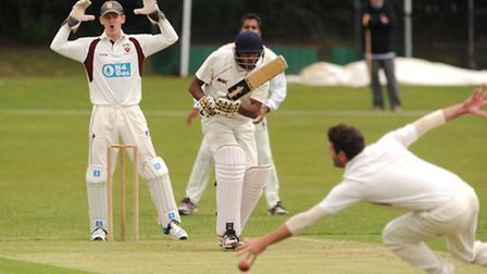 Hampstead batsman Mubasher Hassan just manages to squeeze the ball past Hornsey captain Michael Philipson en route to his...