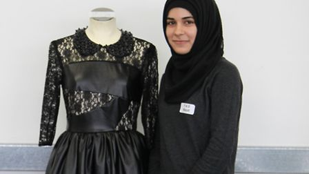 One of the two sixth formers from Newham chosen as a Fashion Futures finalist Hayat Chehab with one of her designs
