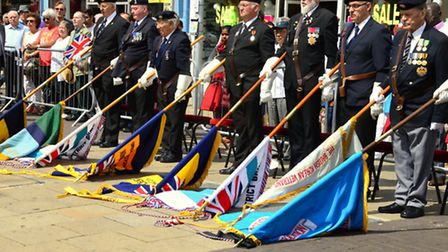 Veterans lowering the colours for fallen comrades during the Ilford service and parade. [Picture: Tony Webb]