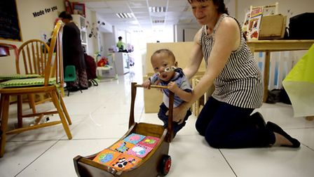 One-year-old Blake Boston-Morris with Gayna Morris, owner of wooden toy company Gee Tots Toys.
