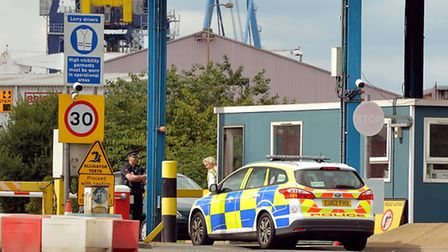 A police car arrives at the main entrance to Tilbury Docks in Essex, where a shipping container was found with illegal...