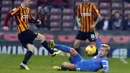 Orient midfielder Josh Wright gets stuck in during the O's 3-1 loss at Bradford City earlier this season. (pic: Simon...