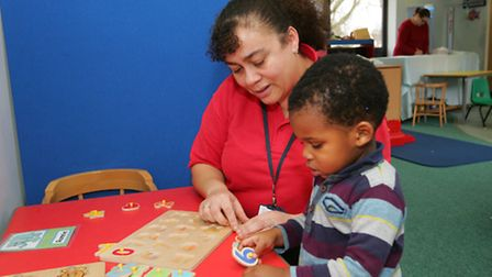Debbie Bennett from First Step with one of the children
