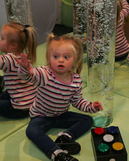 One of the children enjoying the bubble tube in the sensory room