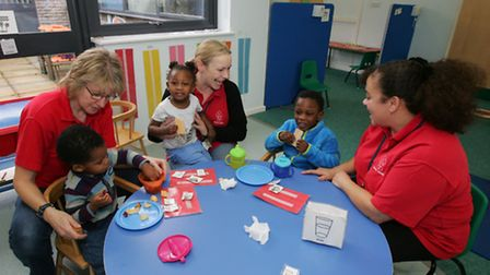 Staff Alison Denyer, Kim Watson and Debbie Bennett with some of the children