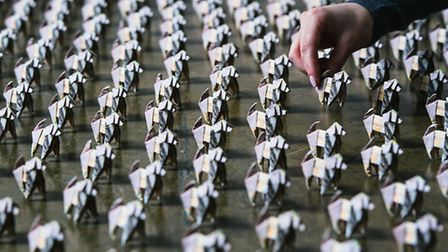 It took a team of experts more than 125 hours to fold the 500 paper Beagles. Picture: Mikael Buck