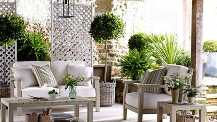 The Dahlia sofa, armchair, coffee table and side table, available from Marks and Spencer