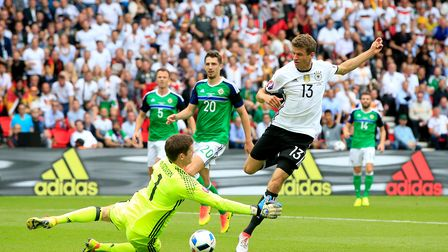 Northern Ireland goalkeeper Michael McGovern (left) saves a shot from close range at the feet of Ger