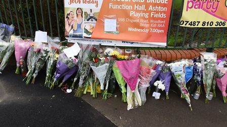 A 16 year old youth has been stabbed to death at Ashton Playing Fields in Woodford Bridge. Floral tributes at the scene