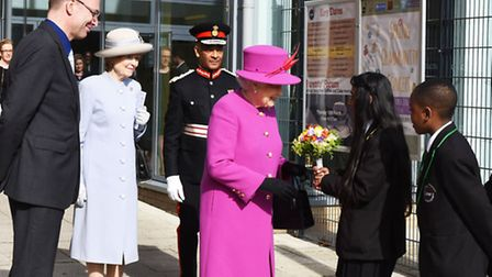 The Queen receives a posy from Nahfiza Begum, 11
