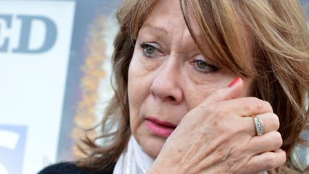 Angela Farrugia, wipes away a tear as she arrives at the blood scandal demonstration in Westminster