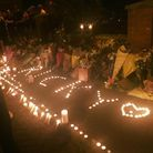 Candle lights were arranged in the name of Ricky outside his home in Gibbfield Close, Chadwell Heath. Photo: Charlotte Jones.