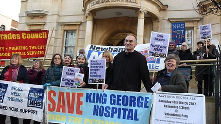 Campaigner Andy Walker, centre, urged councillors to demand 32 acute beds are reopened at King Geoge Hospital, at last...