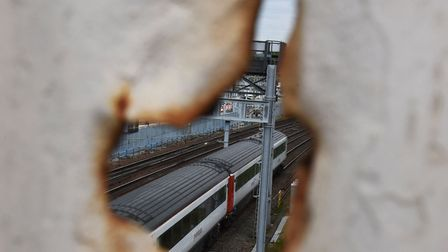 Local historian Ray Lewis on the railway footbridge connecting Ley Street with the High Road which was hit by German...