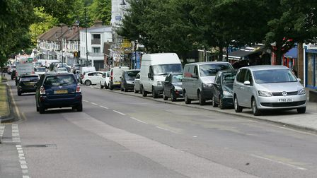 Cars parked in Chigwell Road, residents want to have access to 30 minutes of free parking without using a mobile phone...