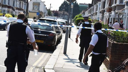Police at the scene of a shooting and stabbing in Eton Road Ilford